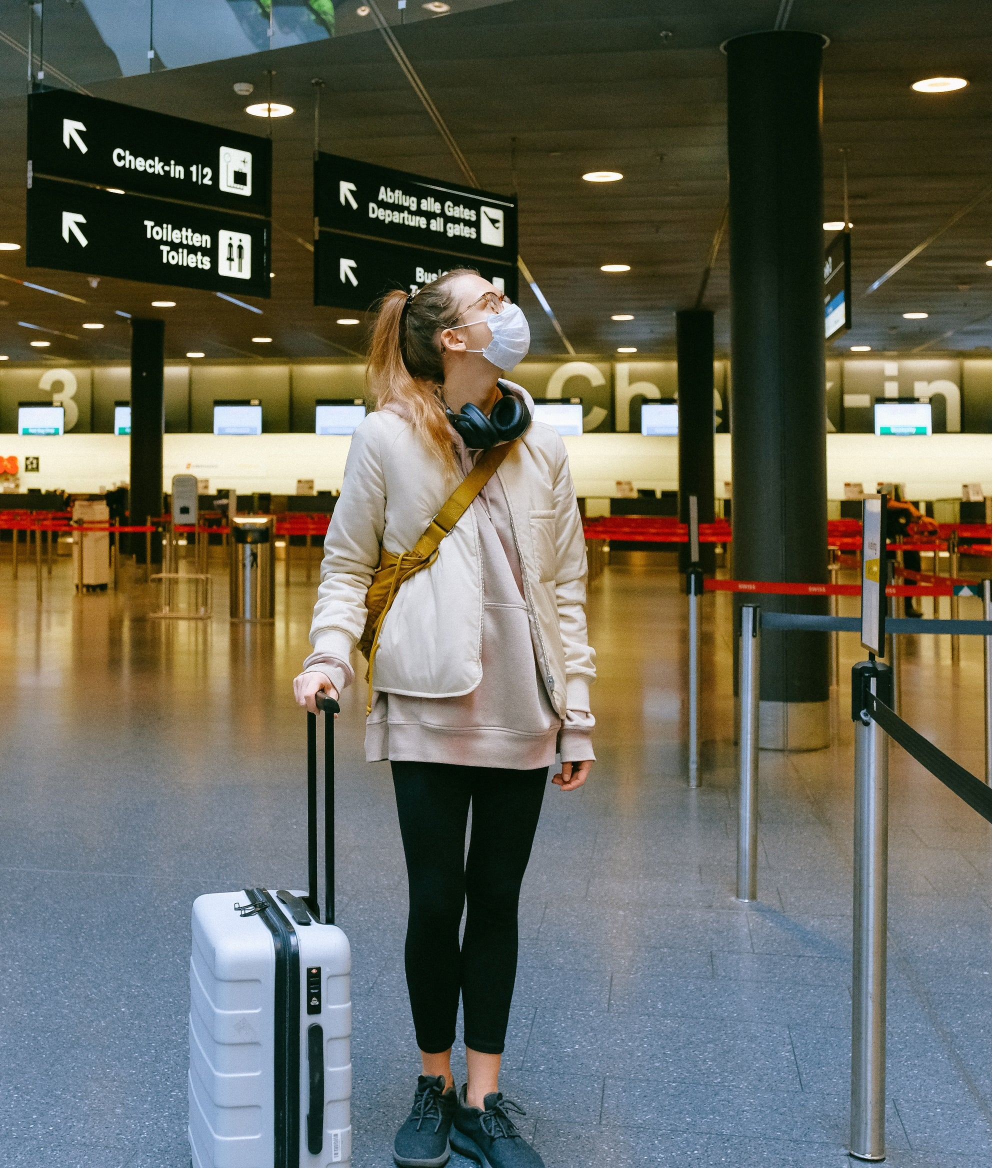 Woman Wearing Face Mask At Airport 3943883 (2)